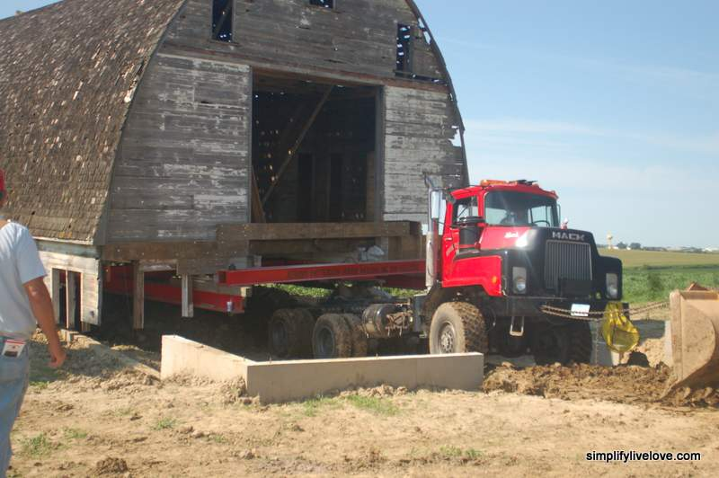 pulling the barn to its new foundation