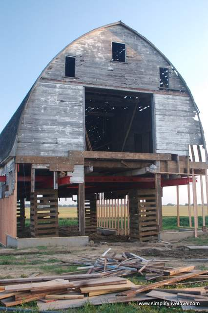 old barn sitting on stilts after being moved