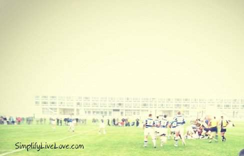 foggy picture of a rugby match at USAFA
