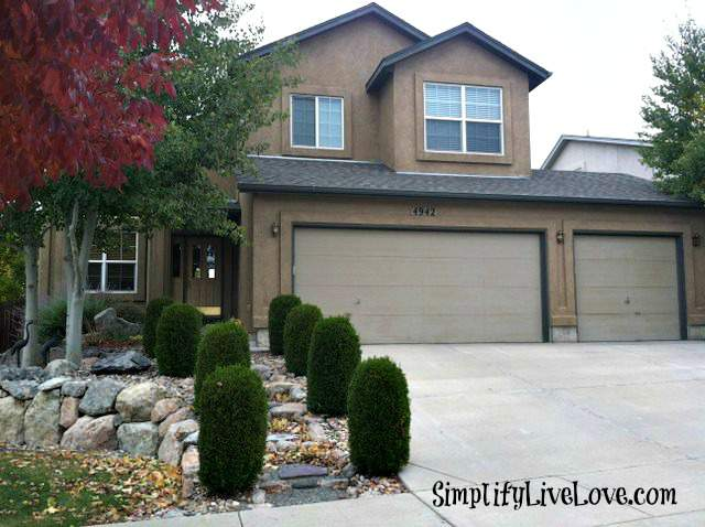 brown stucco house and driveway in Colorado Springs