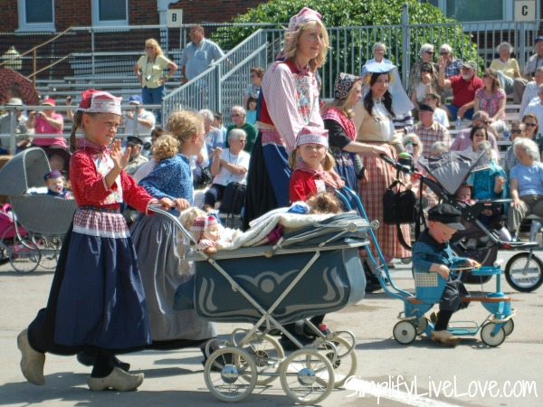 kids pushing old fashioned strollers pella tulip time