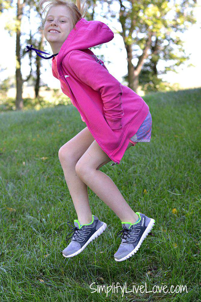Even Homeschooled Kids Get New Back to School Shoes #Twistform #IC #ad Jumping outside from SimplifyLiveLove.com