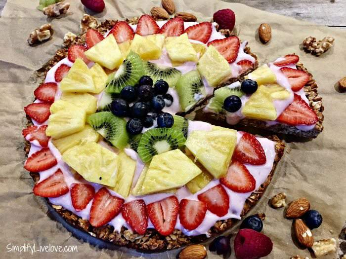 slice and serve the homemade granola fruit pizza