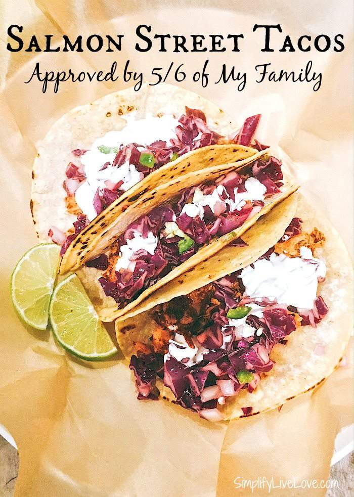 Quick and easy recipe for delicious heart healthy salmon street tacos served with red slaw and lime cream sauce, on the table in 15 minutes!