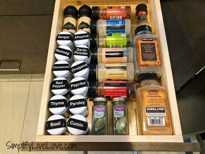 spice drawer with lots of containers of spices