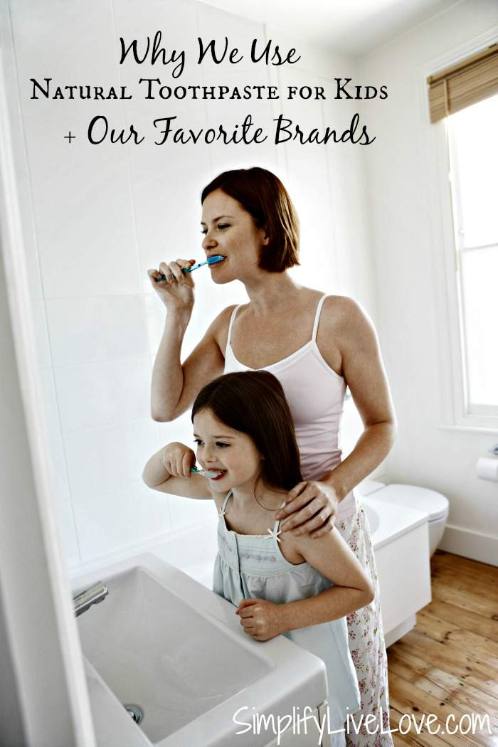mom and daughter brushing teeth with natural toothpaste for kids