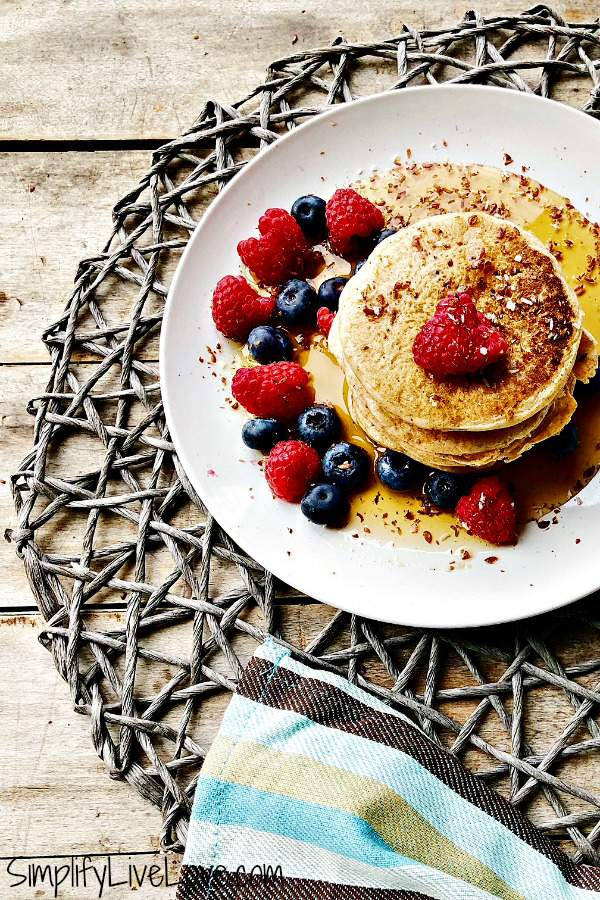 Looking for a dairy free pancake recipe? Almond milk pancakes make delicious fluffy vegan pancakes, are kid and mom approved, and deee-licious! Served with in-season berries, a sprinkle of super food, and wonderful maple syrup, these no egg pancakes will be the hit of your next brunch. #brunchwithbarleans
