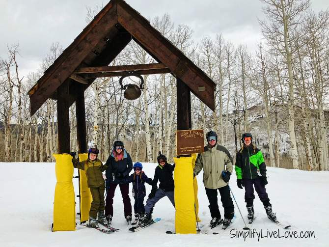 family skiing at the High Places Chapel at Sunlight Mountain Resort