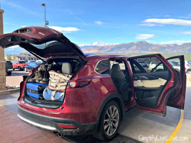 packing up the mazda cx-9 in Colorado Springs with the front range in the background