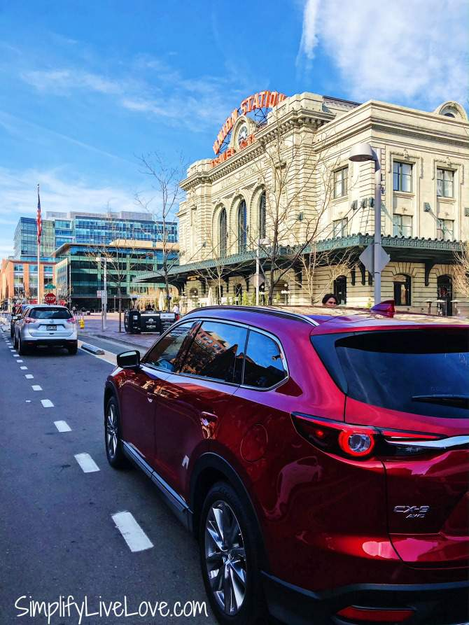 red mazda cx-9 outside union station in Denver
