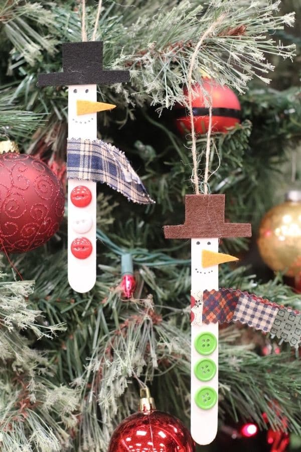 2 snowmen ornaments in tree (1)