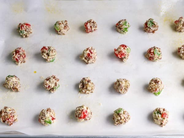 drop fruitcake cookies on parchment paper lined baking sheet