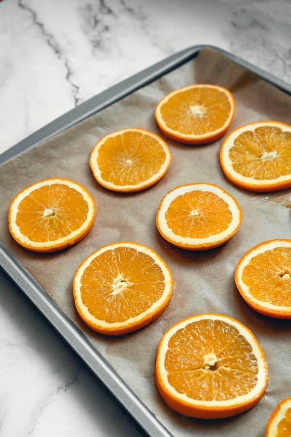 place sliced oranges on parchment paper (1)